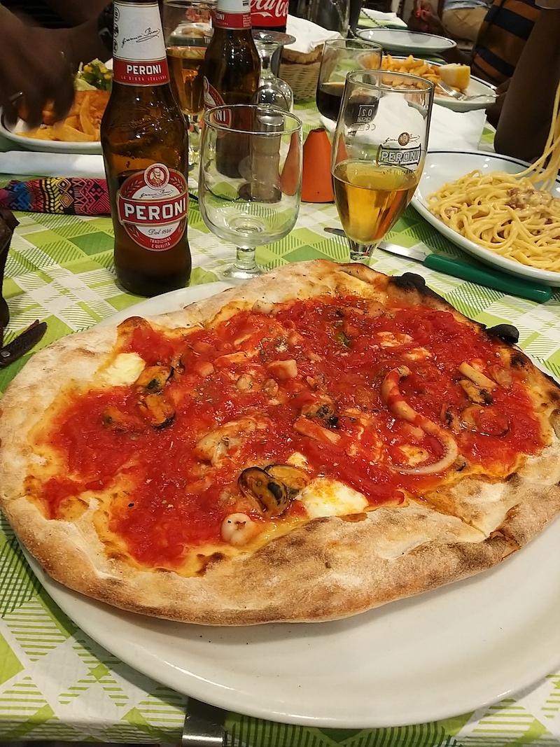 Delicious pizza and Peroni
